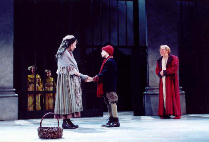 From 2001: The Spirits of Christmas Past (Kristi Flynn and Daryl Rothman) take Scrooge (John Christopher Jones) back to observe his sister, Fan (Janet Metz) and himself as a young boy (Kyle Moore).