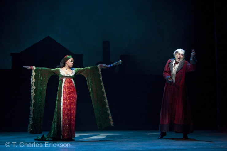 The Spirit of Christmas Present (Cherise Boothe) stops  Scrooge (Graeme Malcolm) in his tracks.