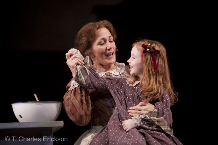 Mrs. Cratchit (Janet Metz) teaches Belida (Hope Springer) how to make the pudding.