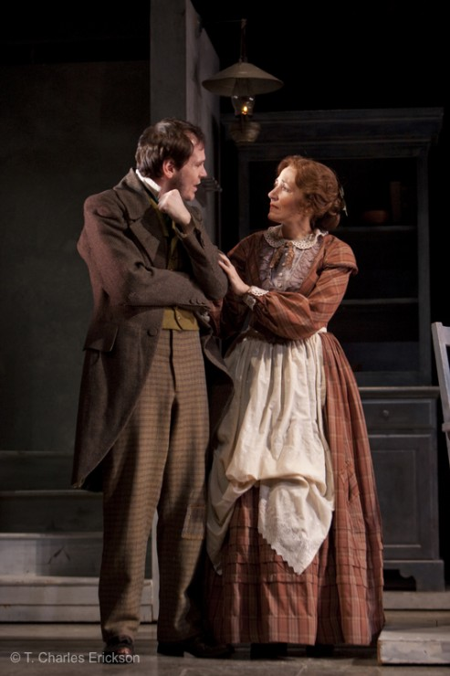 Bob Cratchit (Jon Crombie) and Grace Cratchit (Janet Metz) consider Tiny Tim's condition.