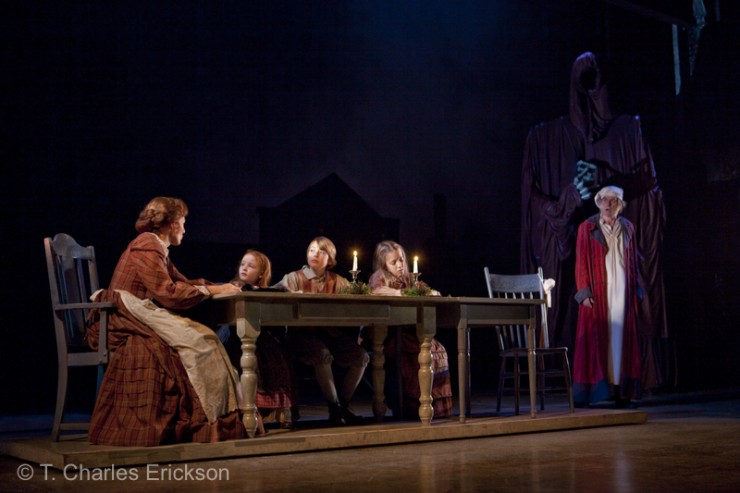 Scrooge (Graeme Malcolm) is shown the Cratchit family (Janet Metz, Hope Springer, Jake Urban and Elsa Rodriguez) after Tiny Tim has died by the Spirit of Christmas Yet To Come.