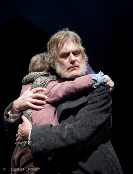 The final embrace of Scrooge (Graeme Malcolm) and Tiny Tim (Noah Hinsdale).