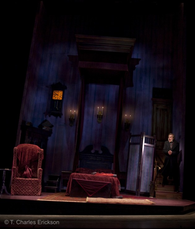 Scrooge (Graeme Malcolm) enters his cold, dank bedroom.