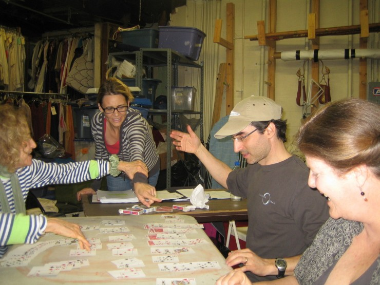 Figuring out the card game in rehearsal