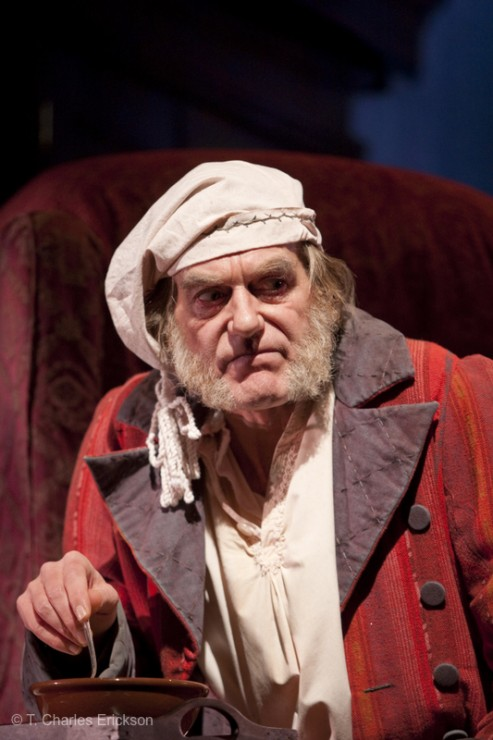Scrooge (Graeme Malcolm) hears voices.