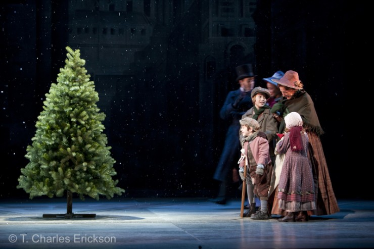 The Cratchit family (Noah Hinsdale, Jake Urban, Janet Metz and Hope Springer) gaze at the tree.