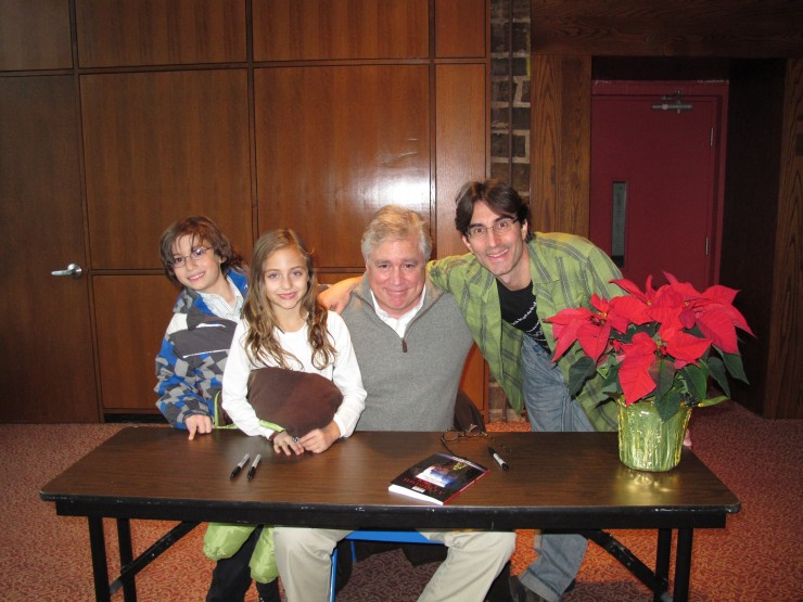 The director (Michael Unger) and his kids at the book signing with Adapter David (Tommy) Thompson.