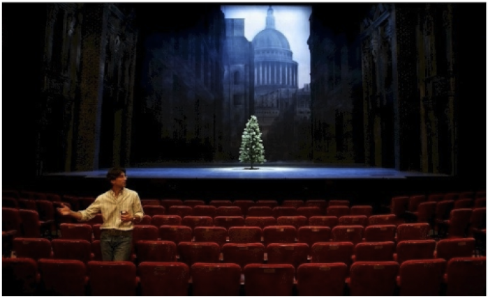 "Michael Unger in front of the opening set for ""A Christmas Carol"" at McCarter Theatre - designed by Ming Cho Lee - Photo by T. Charles Erickson"