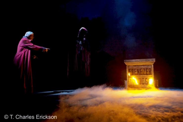Scrooge (Graeme Malcolm) sees his name etched by flames into his tombstone.