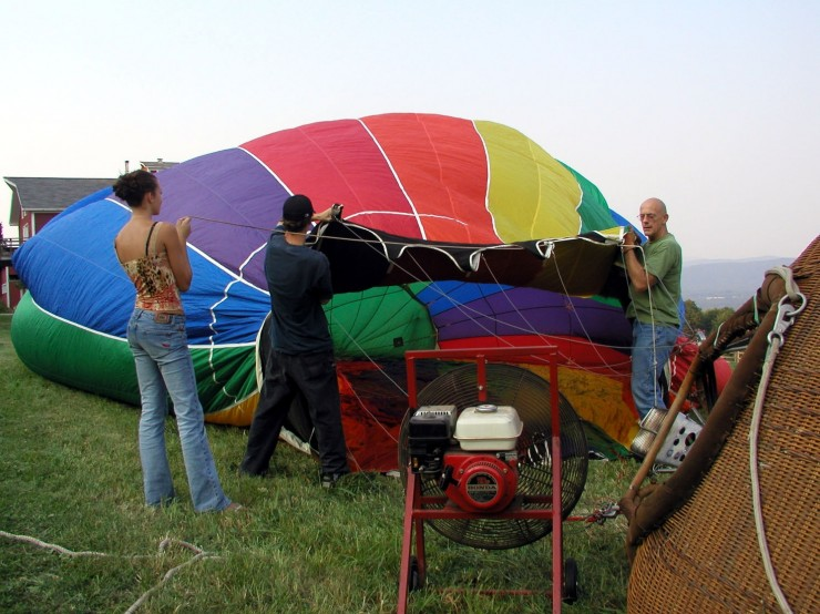 Chris Lloyd helping to blow up balloon
