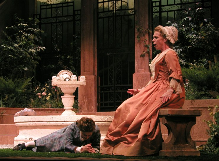 Leonide (Ali Marsh) falls at the feet of Leontine (Amy Van Nostrand) in a crafty effort to woo and dupe.