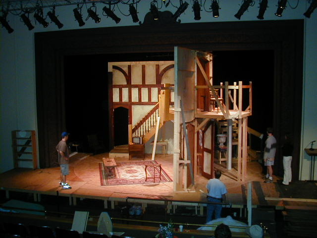 The set - mid transition - designed by Todd Rosenthal