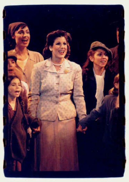 "Ruth (Stephanie J. Block) tells the refugees of all the wonders of their new home, ""Oswego"" New York, USA."