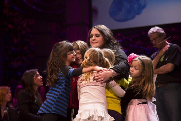 Nikki Blonsky hugging the girls